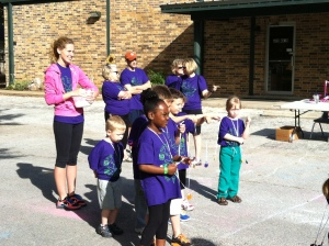 Fun run - handing out medals at the end of the race