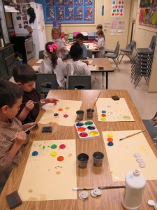 Students painting medals
