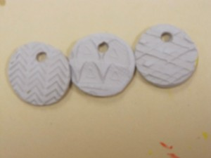 Clay medals with running shoe imprints