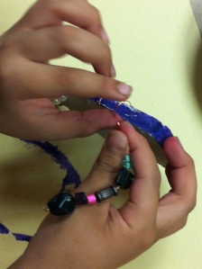 Threading beads on to wire
