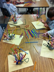 Kindergarteners sculpting with pipe cleaners